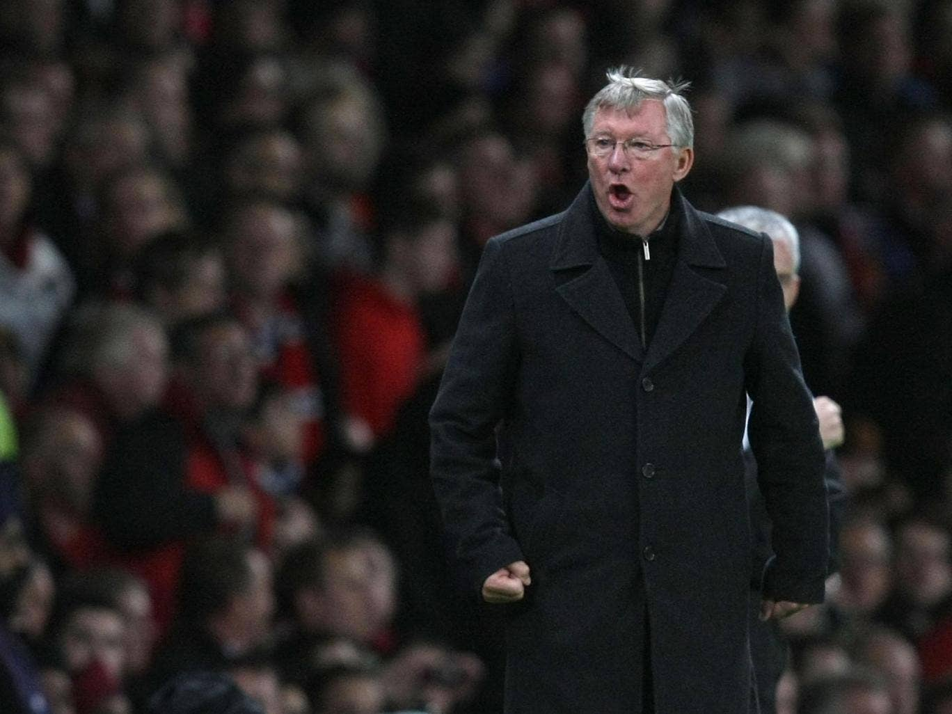 Sir Alex Ferguson of Manchester United complains to the assistant referee during the Barclays Premier League match between Manchester United and Newcastle United