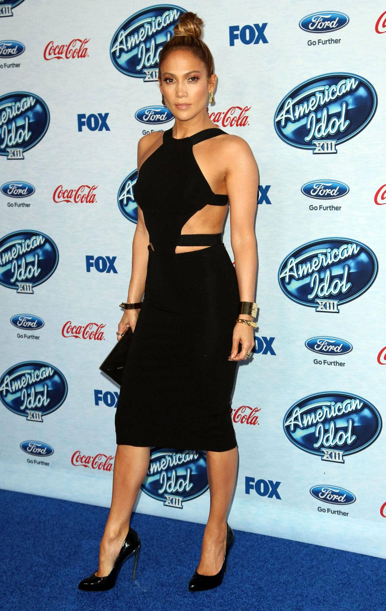 It takes Lopez's toned body and well-flexed confidence to pull this bandage dress off