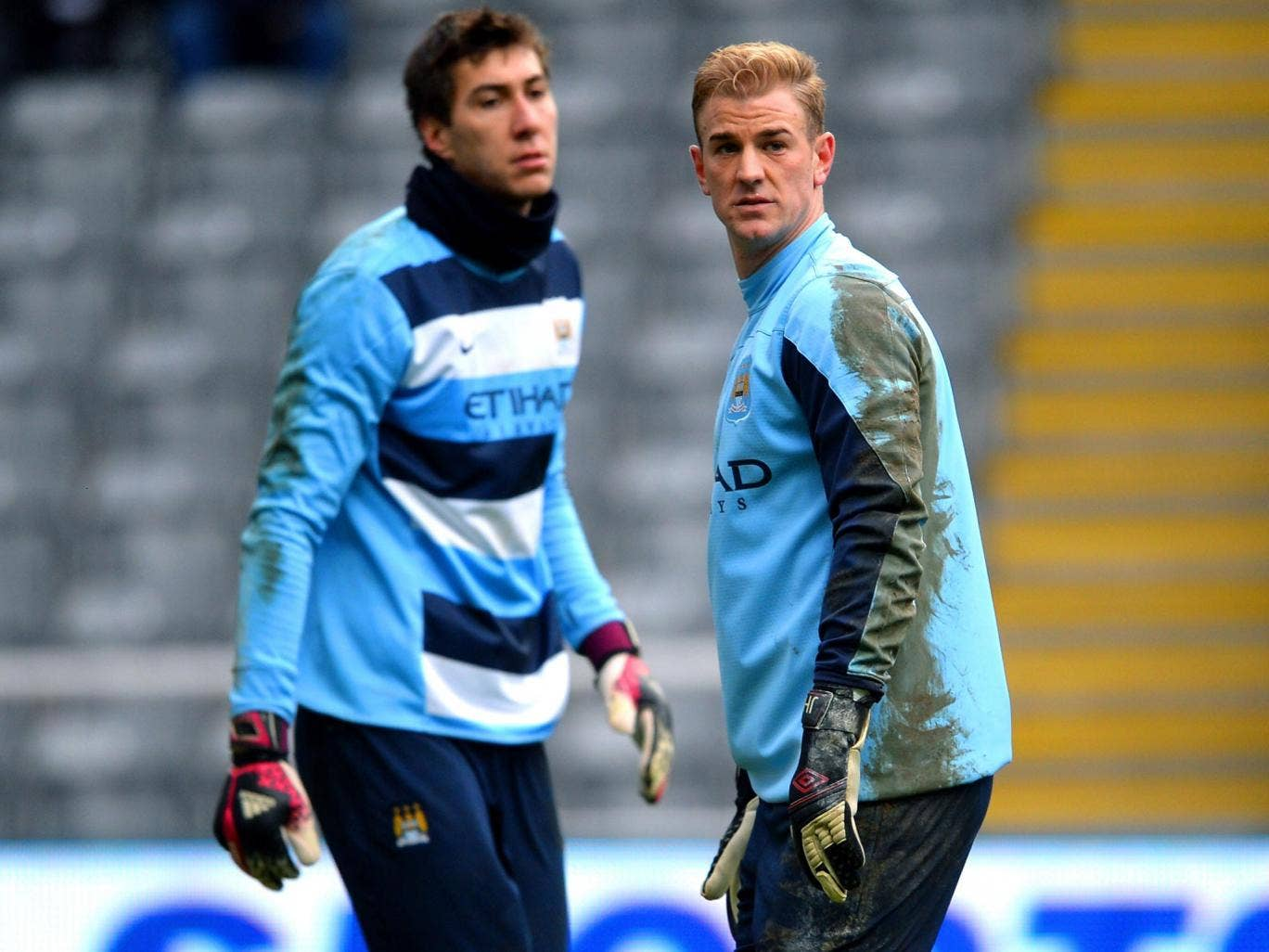 Costel Pantilimon and Joe Hart (right) are vying to play in goal for Manchester City tomorrow