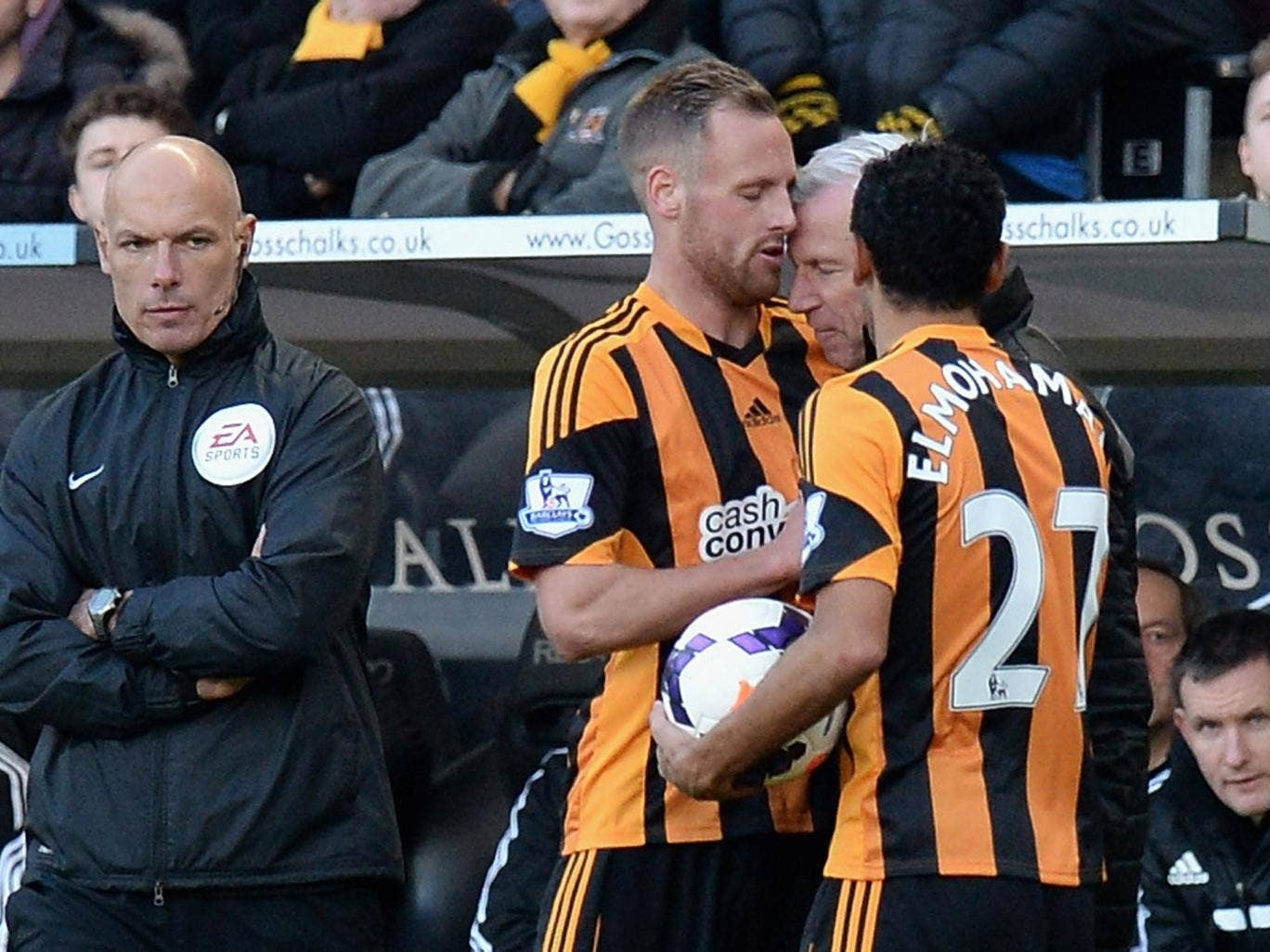 David Meyler of Hull City clashes with Alan Pardew, Manager of Newcastle United during the Barclays Premier League match between Hull City and Newcastle United