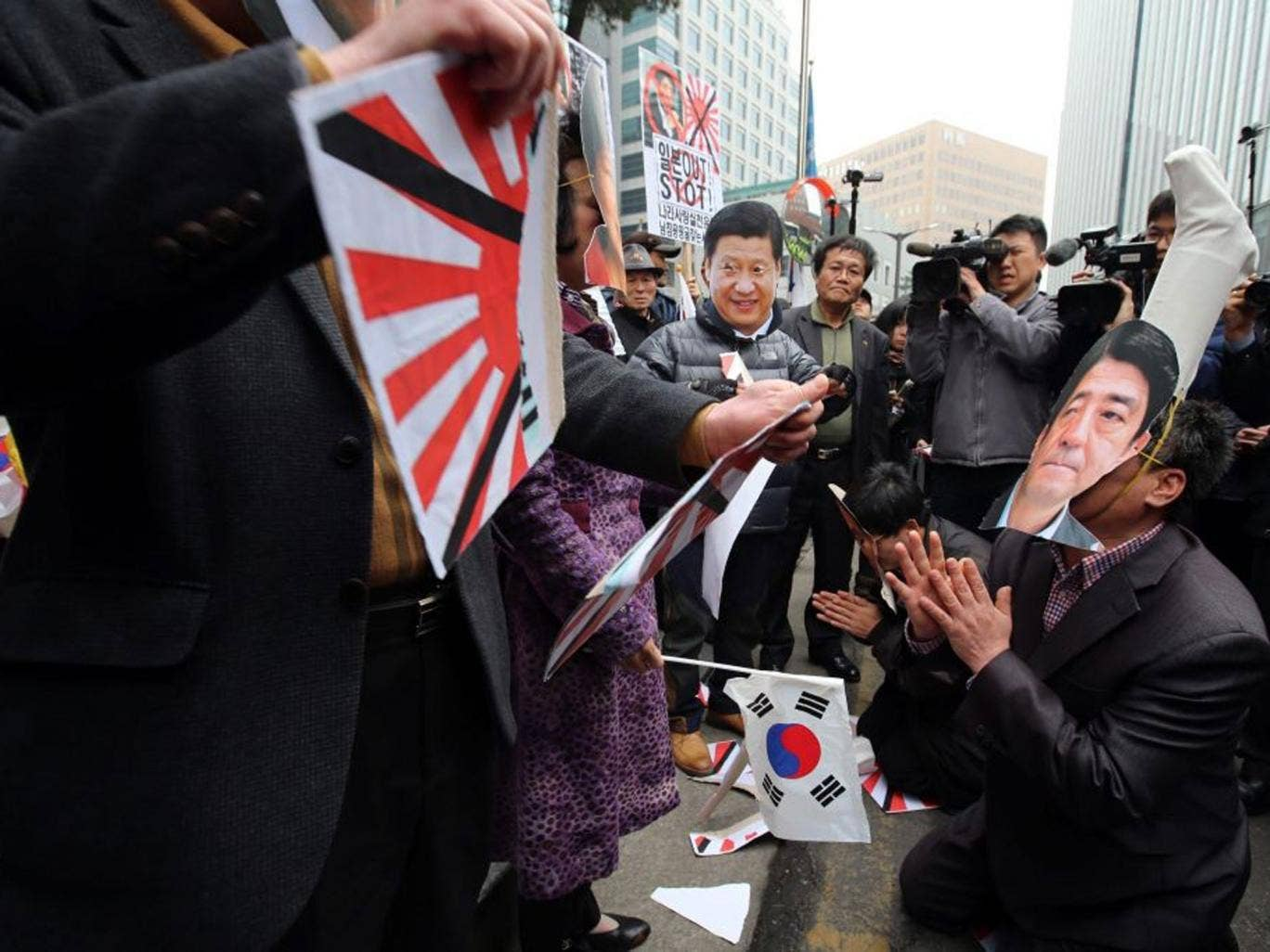 Protesters outside the Japanese embassy in Seoul yesterday