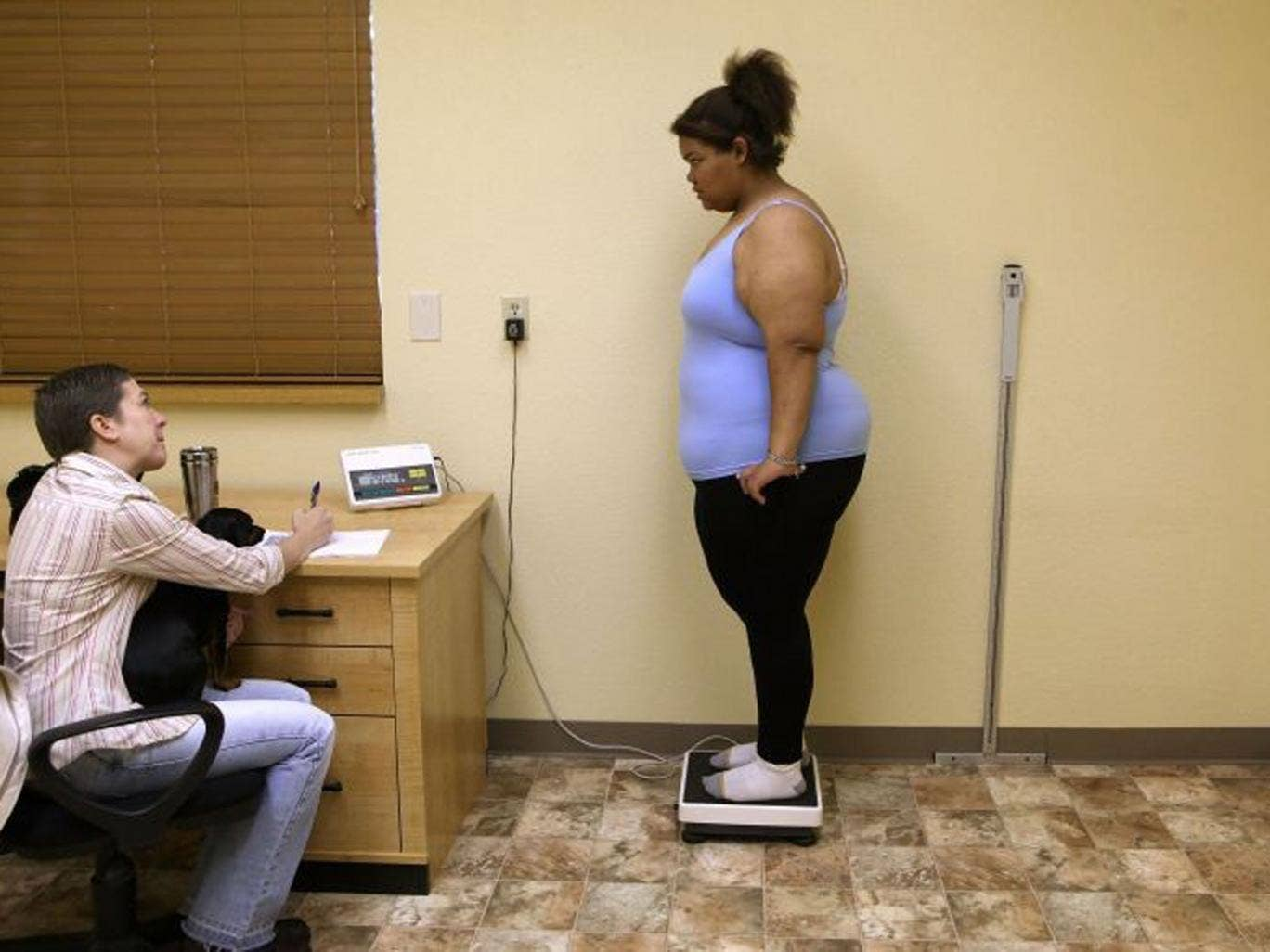 Heavy task: A 17-year-old  US student gets to grips with her weight