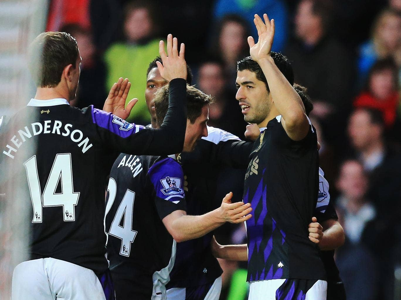 Luis Suarez celebrates his goal with his Liverpool team-mates during the 3-0 victory over Southampton
