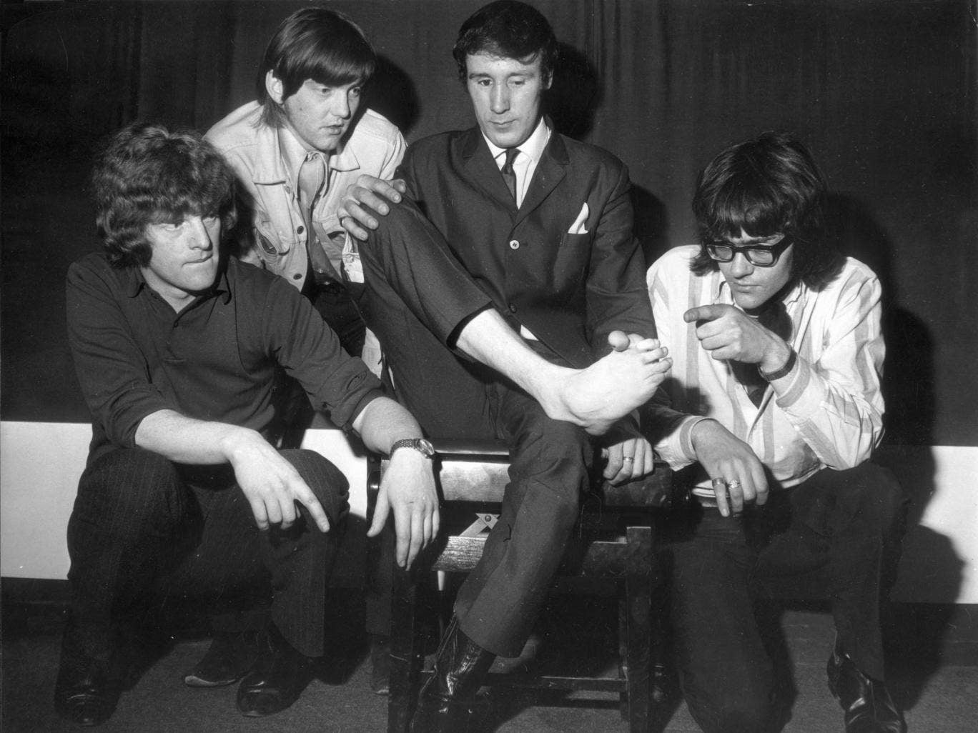 Lee's band in 1968, including Ian Hunter, far left, inspect the foot with which Lee played the piano