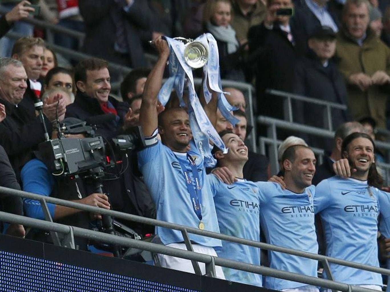 Manchester City captain Vincent Kompany holds aloft the trophy after defeating Sunderland to win the English League Cup final match at Wembley Stadium (Reuters)