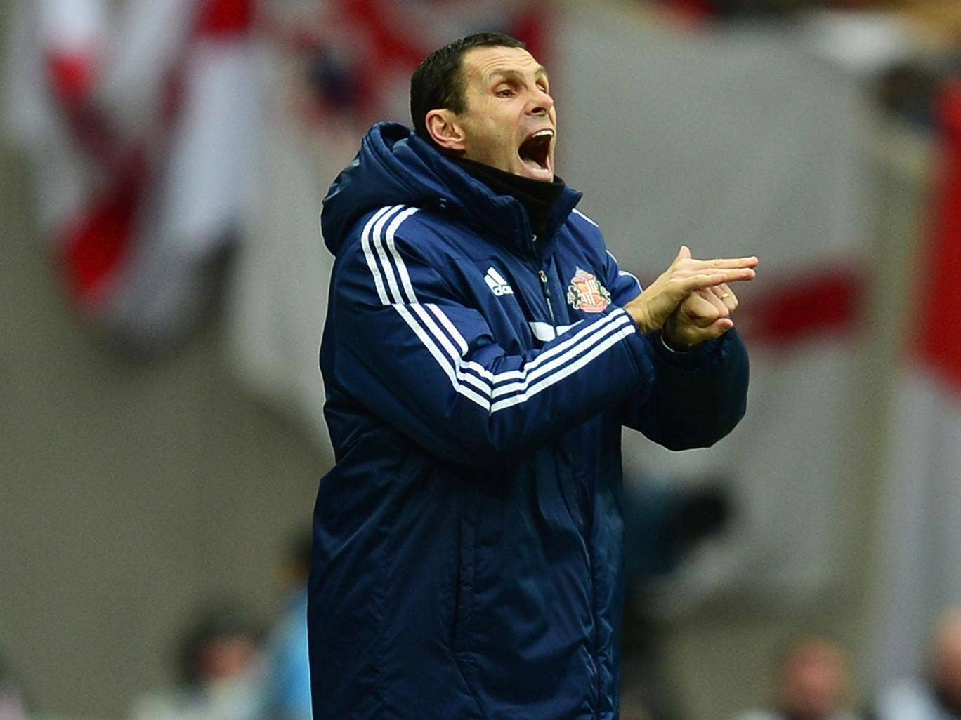 Gus Poyet makes a gesture from the touchline at Wembley