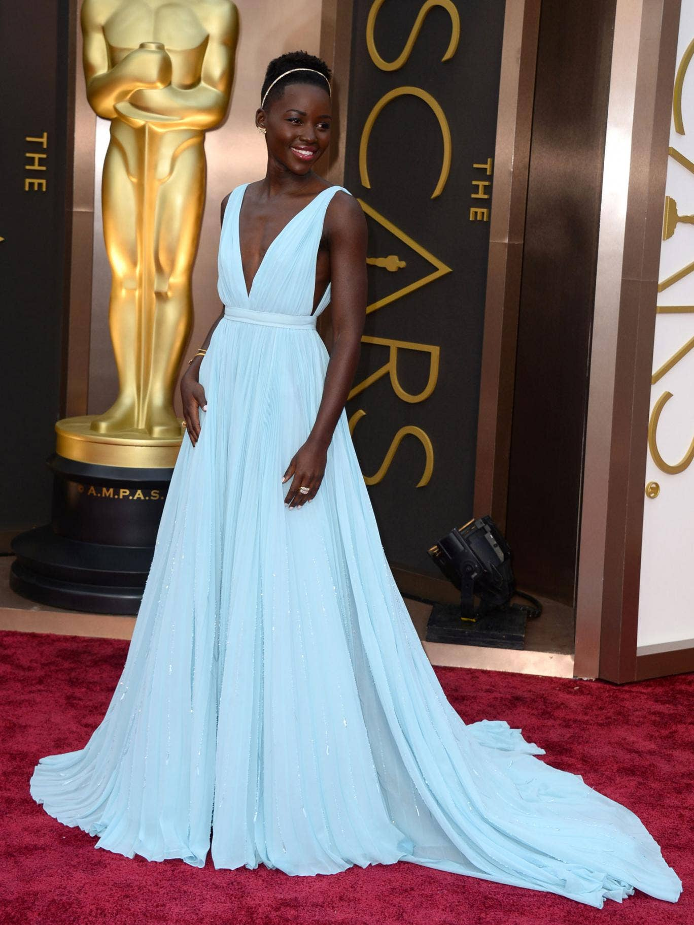 Lupita Nyong'o stuns in a plunging pale blue dress at the 86th Academy Awards