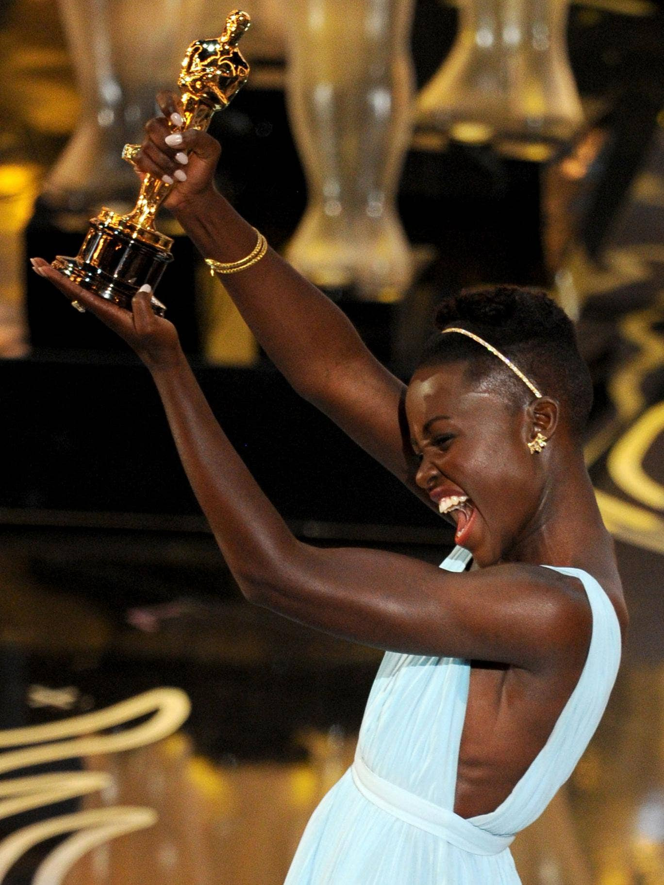 Lupita Nyong'o accepting her Oscar for Best Supporting Actress