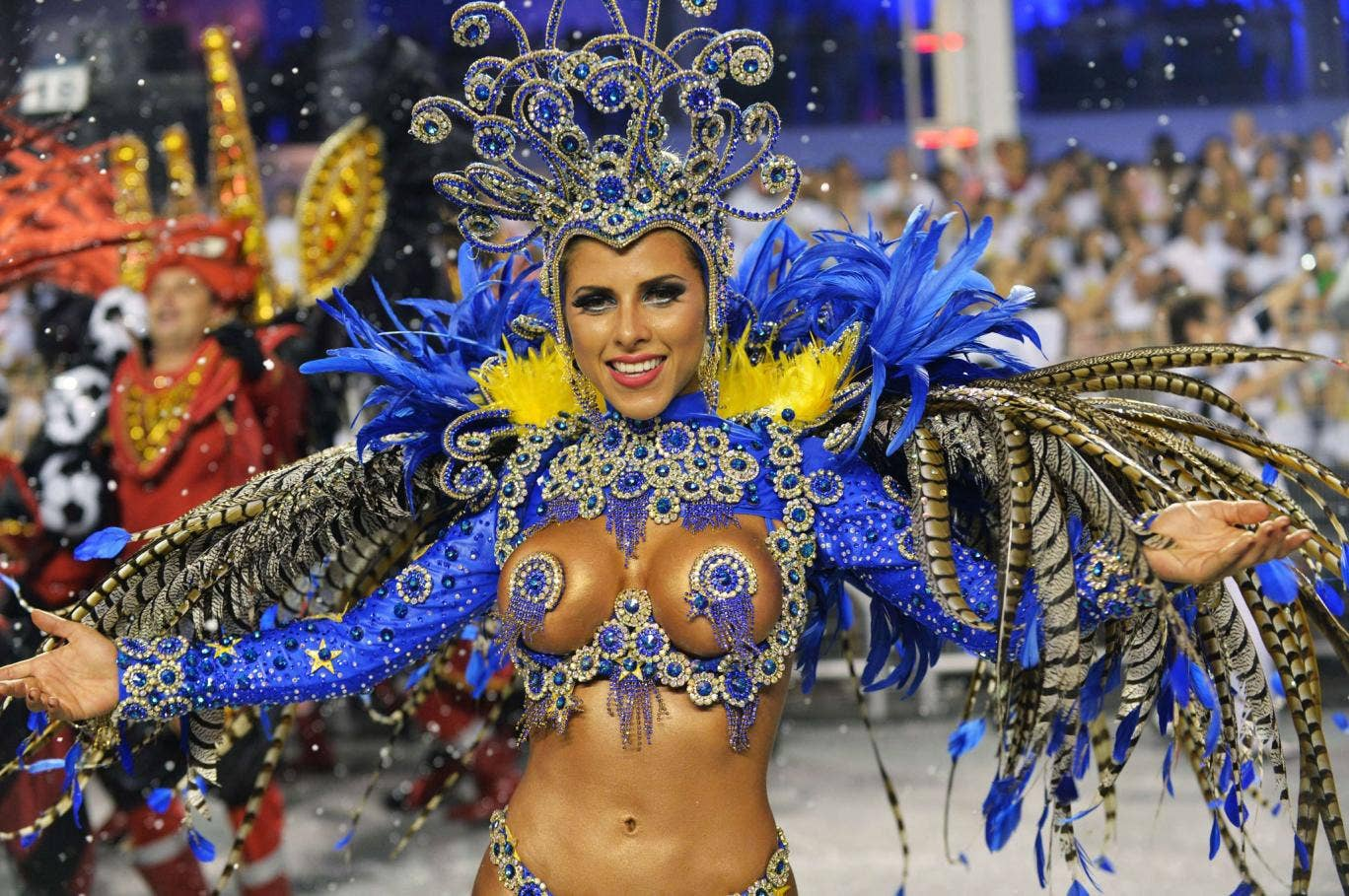 A dancer of the Gavioes da Fiel samba school performs during the second night of carnival parade at the Sambadrome in Sao Paulo