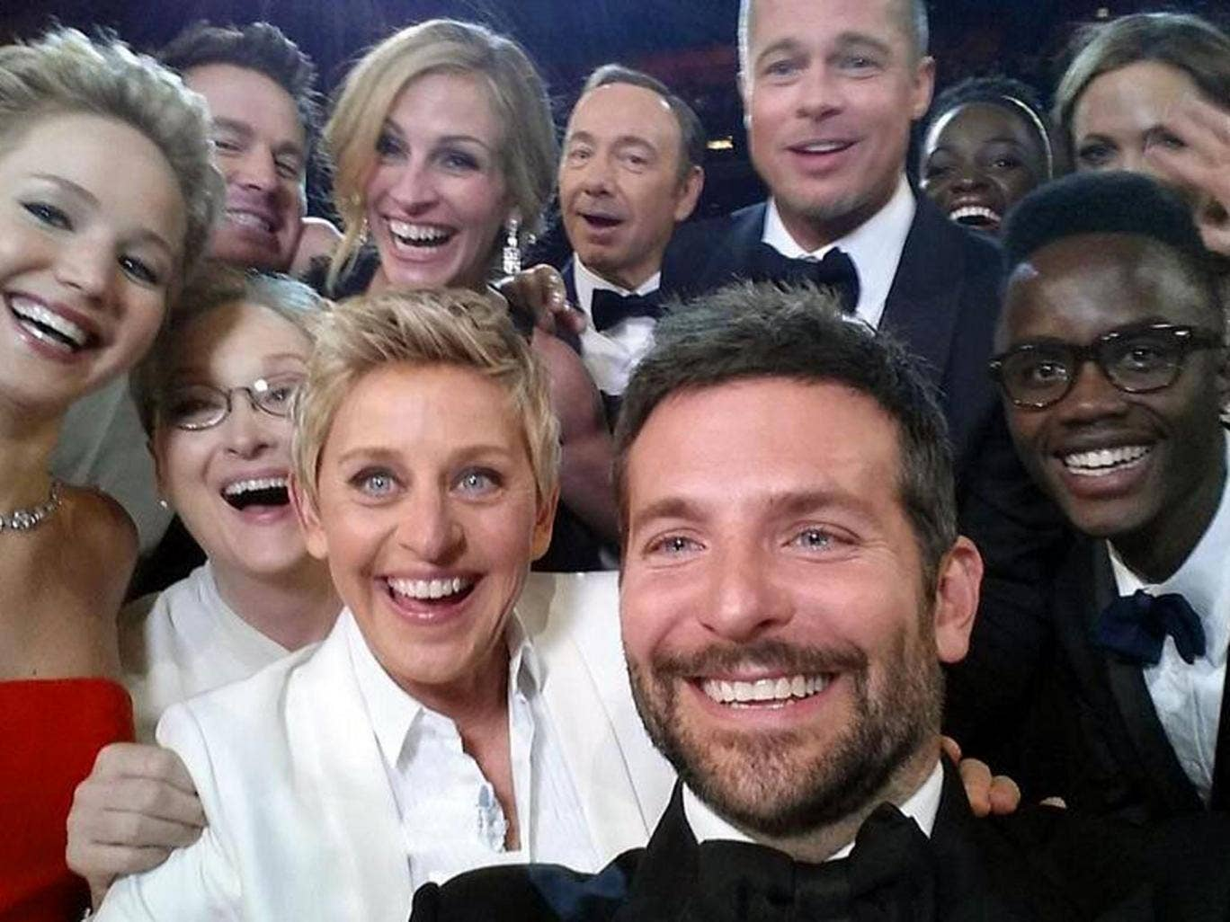 Actors front row from left, Jared Leto, Jennifer Lawrence, Meryl Streep, Ellen DeGeneres, Bradley Cooper, Peter Nyongío Jr., and, second row, from left, Channing Tatum, Julia Roberts, Kevin Spacey, Brad Pitt, Lupita Nyongío and Angelina Jolie as they pose