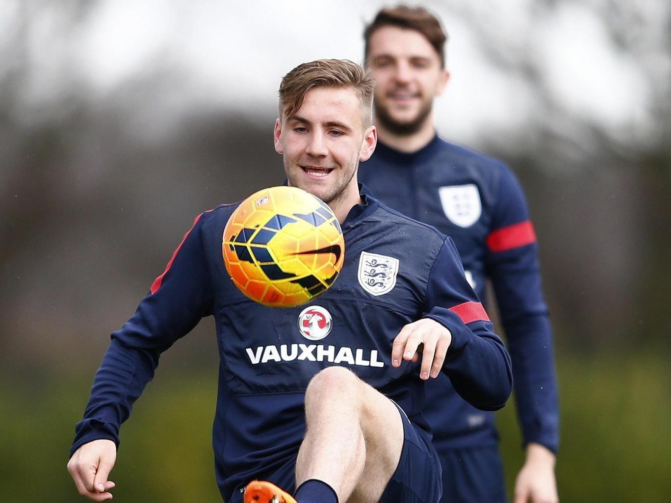 Jay Rodriguez (back) watches Southampton team-mate Luke Shaw at England training yesterday