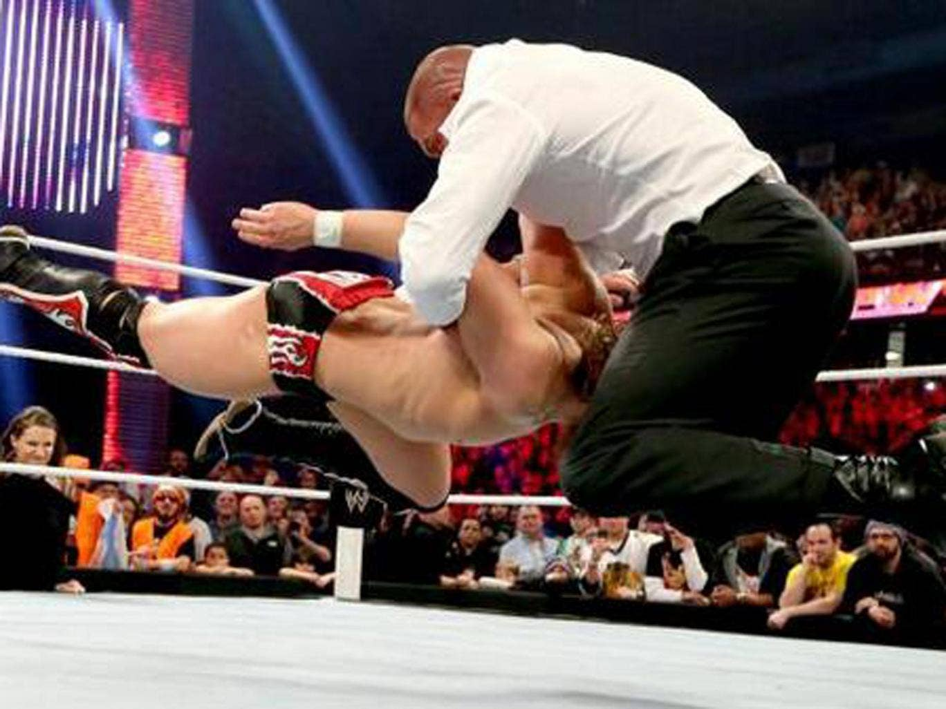 Triple H delivers a pedigree to Daniel Bryan on Raw in Chicago