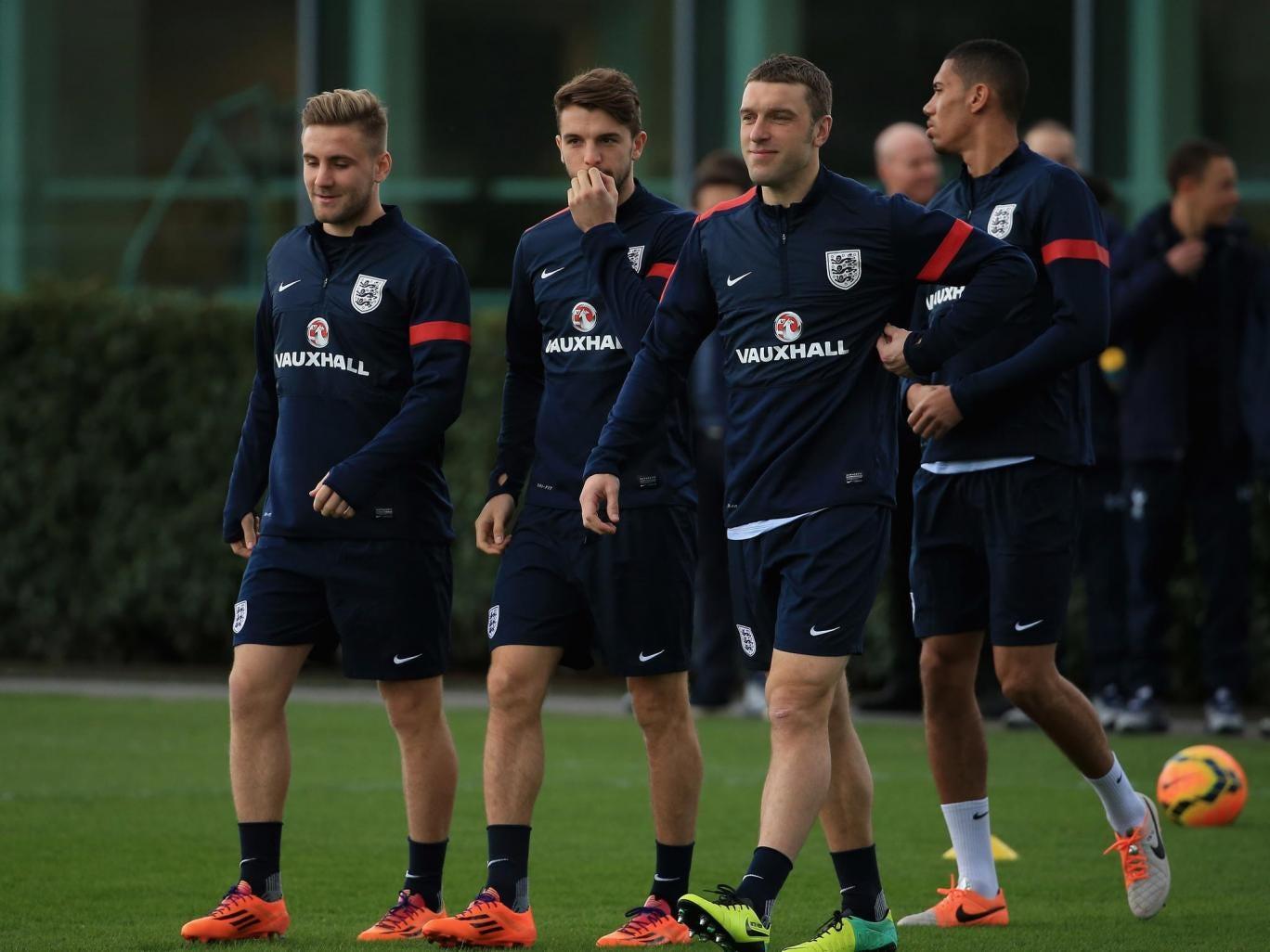 England's Southampton contingent Luke Shaw (L) Adam Lallana (C) and Rickie Lambert (R)