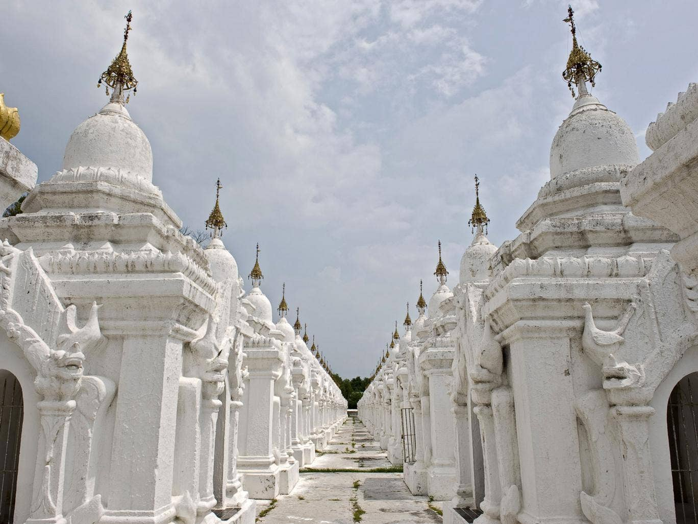 Some of the 729 stupas of the Kuthodaw pagoda in Mandalay. The pagoda contains the world's largest book, and lies at the foot of Mandalay Hill