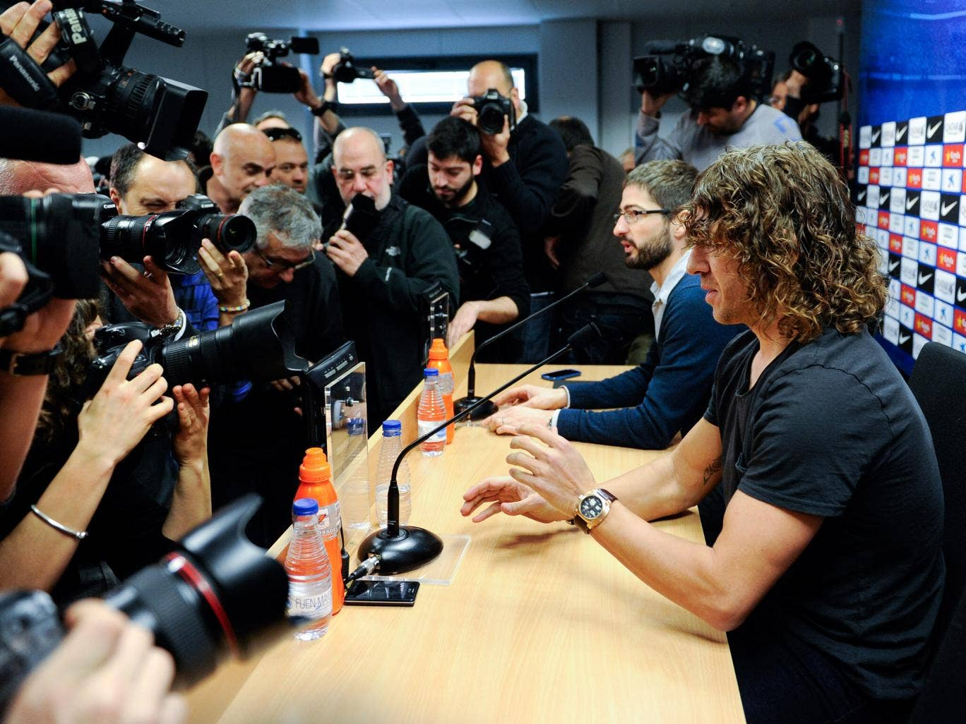 Carles Puyol of FC Barcelona faces the media during a press conference to announce he will be leaving the Catalan club at the end of the season