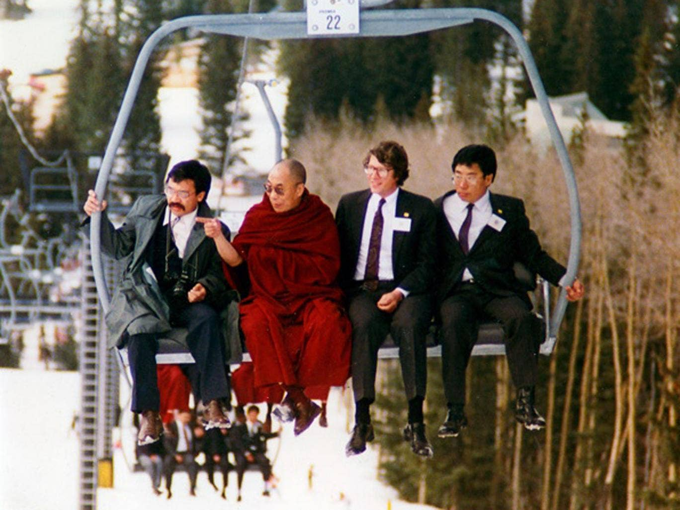Snow job: the Dalai Lama on a ski-lift in Santa Fe, taken by the late Bob Shaw