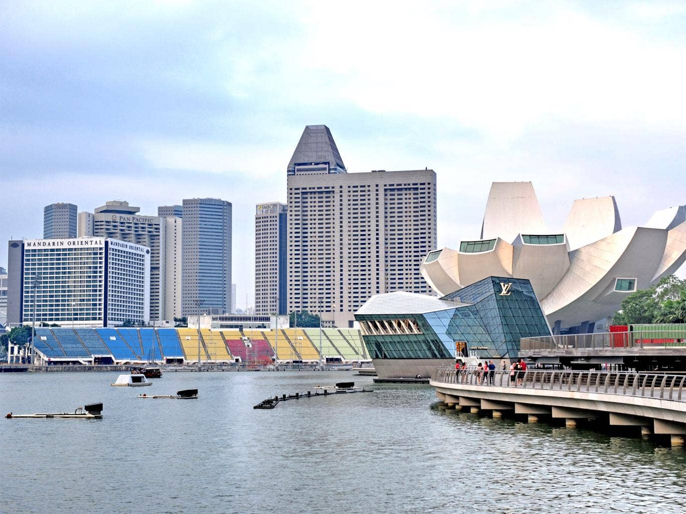 The Marina Bay promenade in Singapore. The arrival of wealthy foreigners in the booming financial centre has helped to drive up prices
