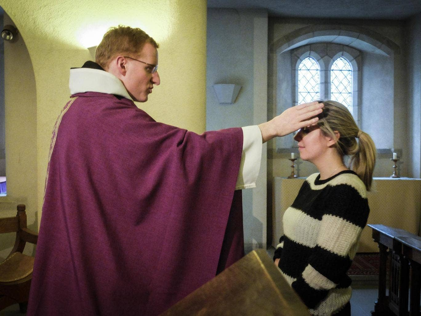Father Luke Beckett takes Mass in the crypt