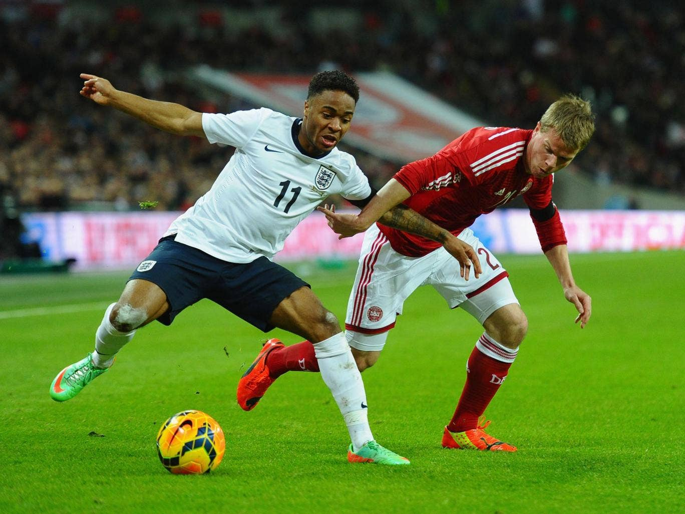 Raheem Sterling battles for the ball and should be in the squad for Brazil