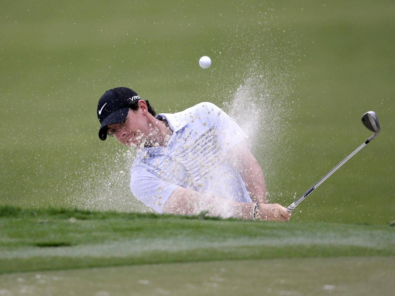 Rory McIlroy of Northern Ireland, hits from a 12th hole sand trap during the first round of the Cadillac Championship golf tournament