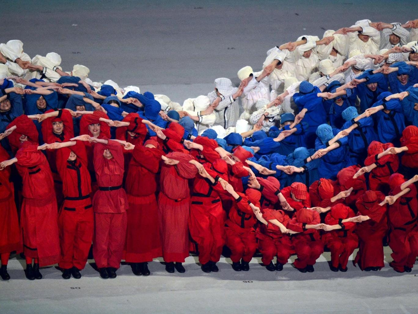Performers simulate the Russian flag moving in the wind during the opening ceremony of the Paralympic Winter Games
