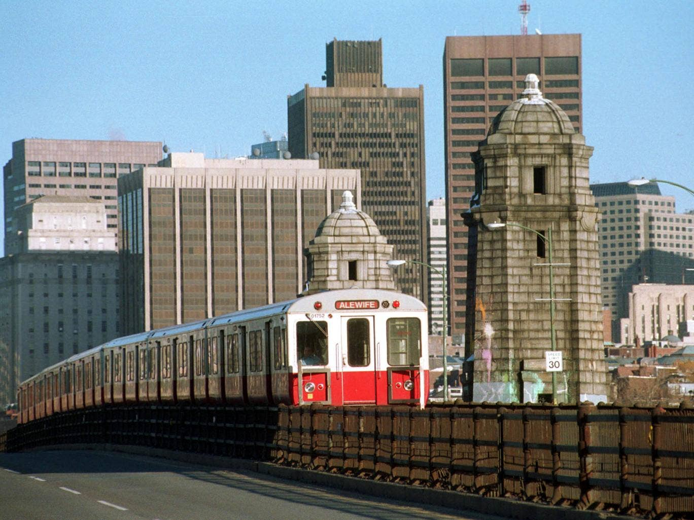 A Red Line subway car, known as the T in Boston, crosses the Charles River March 12, 2001 in Cambridge, MA. Boston's subway system, the oldest in the nation, has plans to auction off the rights to name four of its busiest stations. Last week's pre-bid mee