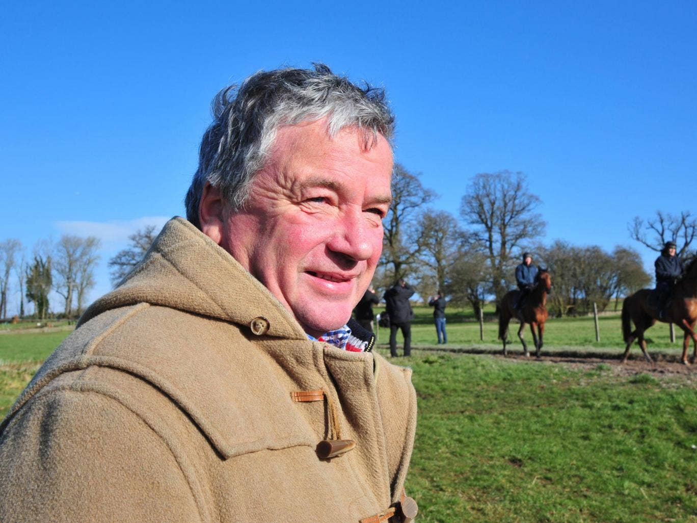 Nigel Twiston-Davies watches his horses ride out at Grange Hill Farm
