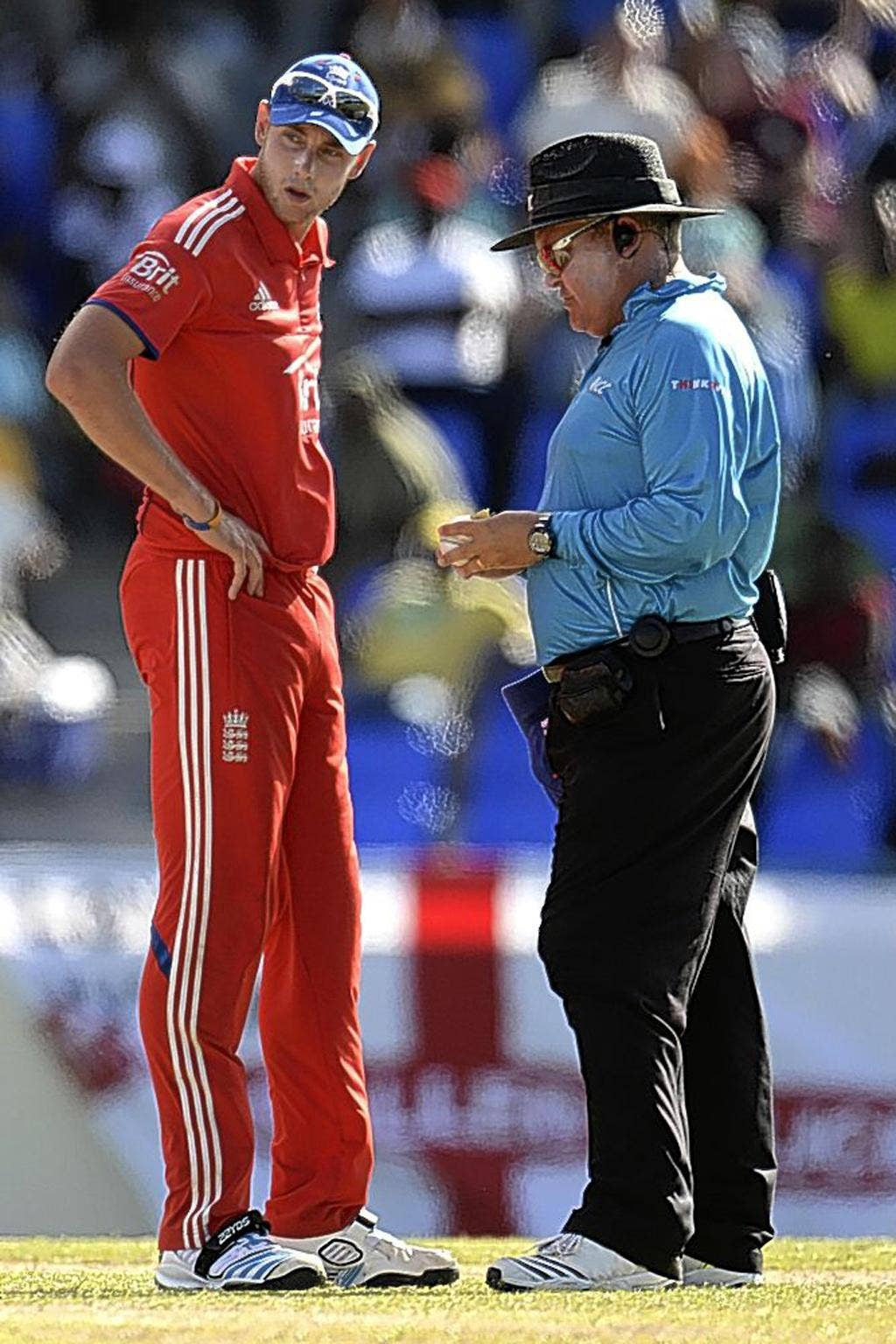 Stuart Broad is consulted by umpire Marais Erasmus over the condition of the ball
