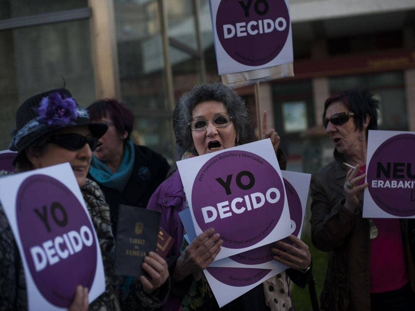 Women carry placards saying 'I decide' during the protests