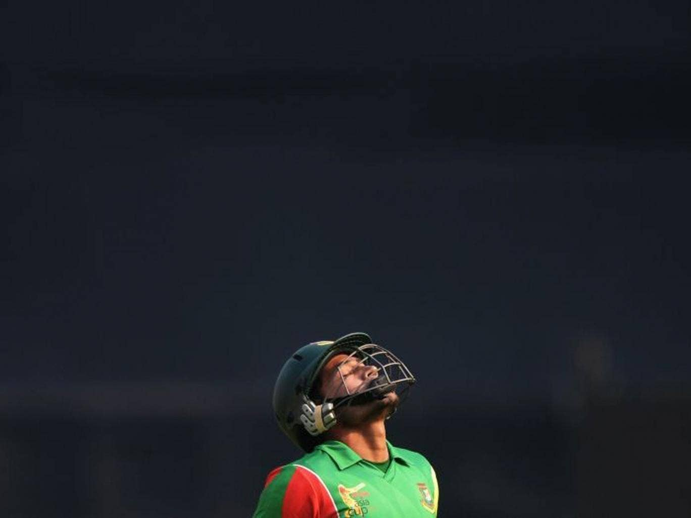 Bangladeshi captain Mushfiqur Rahim  reacts as he walks back to the dressing room after losing his wicket