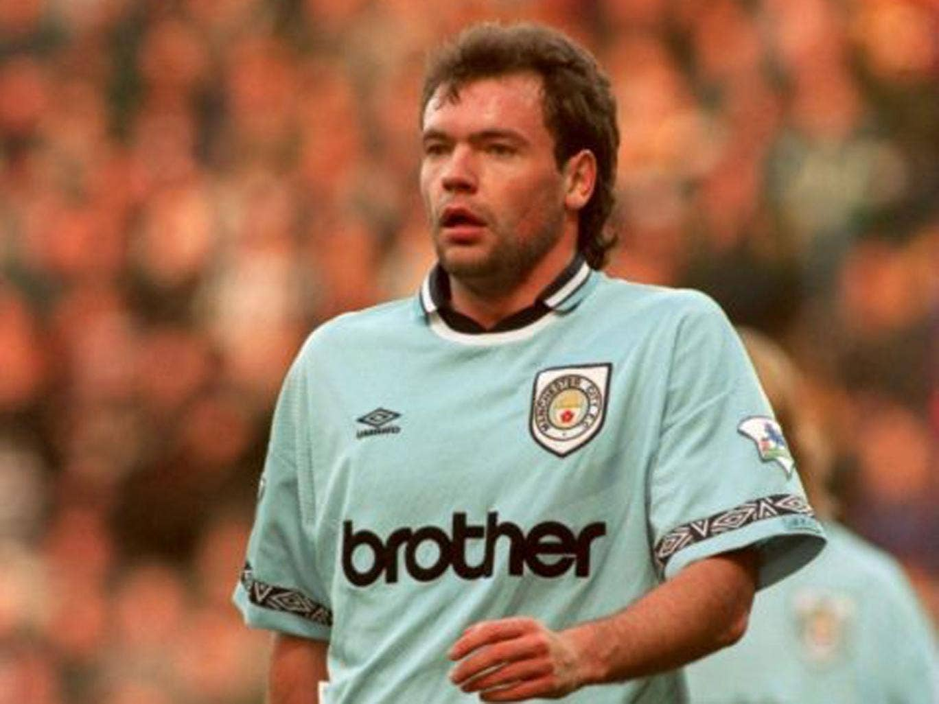 City slicker: Uwe Rösler in action for Manchester City in 1995
