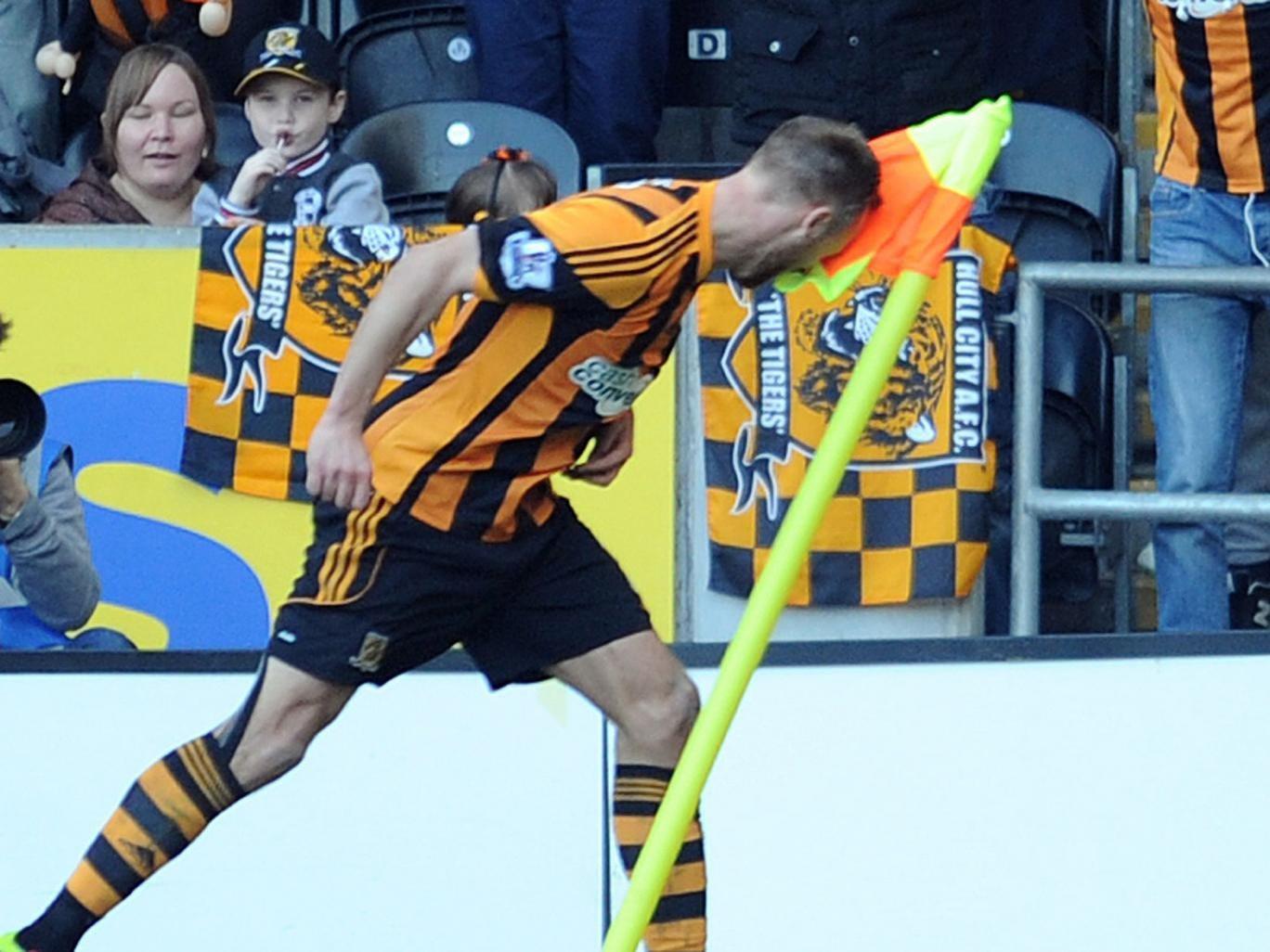 Hull's David Meyler celebrates his goal by headbutting the corner flag