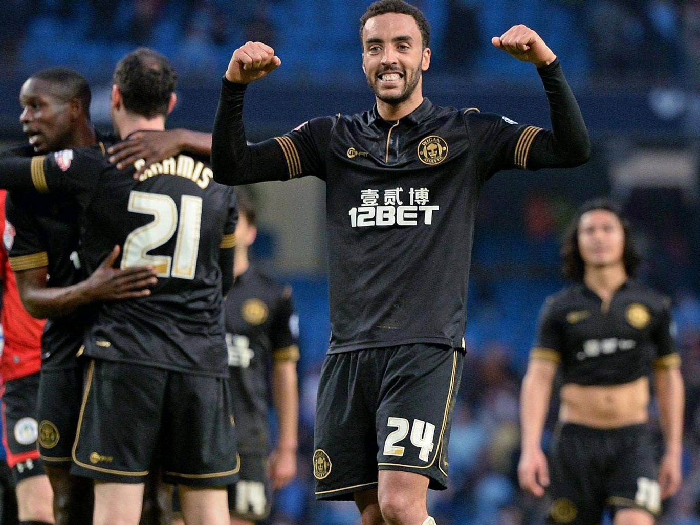 Wigan Athletic's James Perch celebrates at the final whistle after his goal helped knock Manchester City out of the FA Cup at the Etihad Stadium