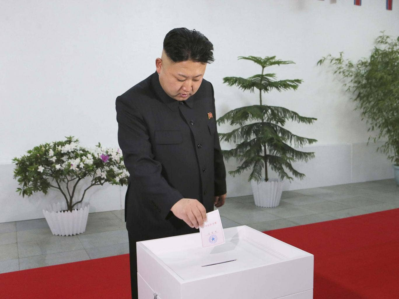 North Korean leader Kim Jong Un takes part in the election of a deputy to the Supreme People's Assembly at sub-constituency No. 43 of Constituency No. 105
