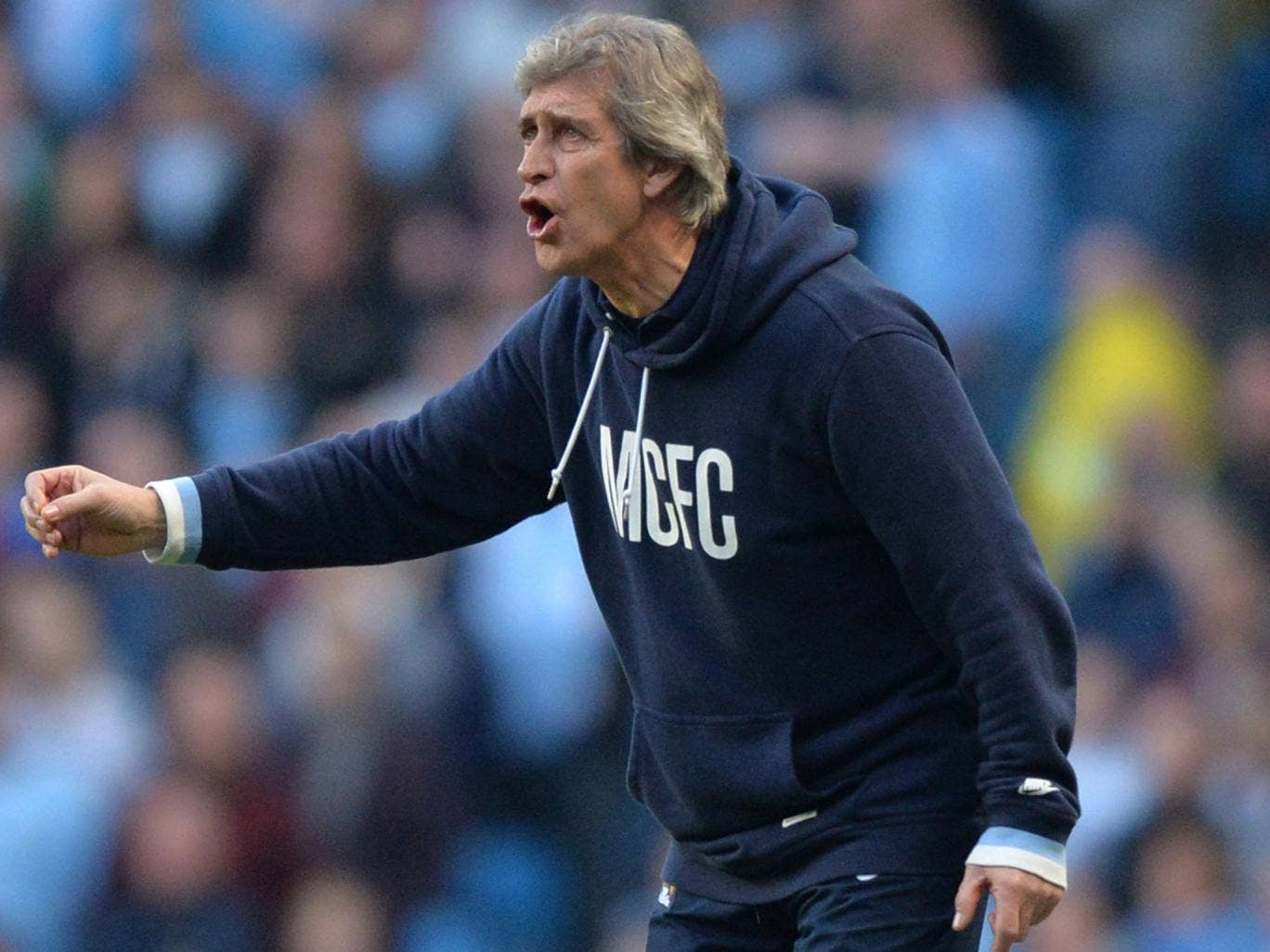 Manuel Pellergini makes a gesture from the touchline on Sunday