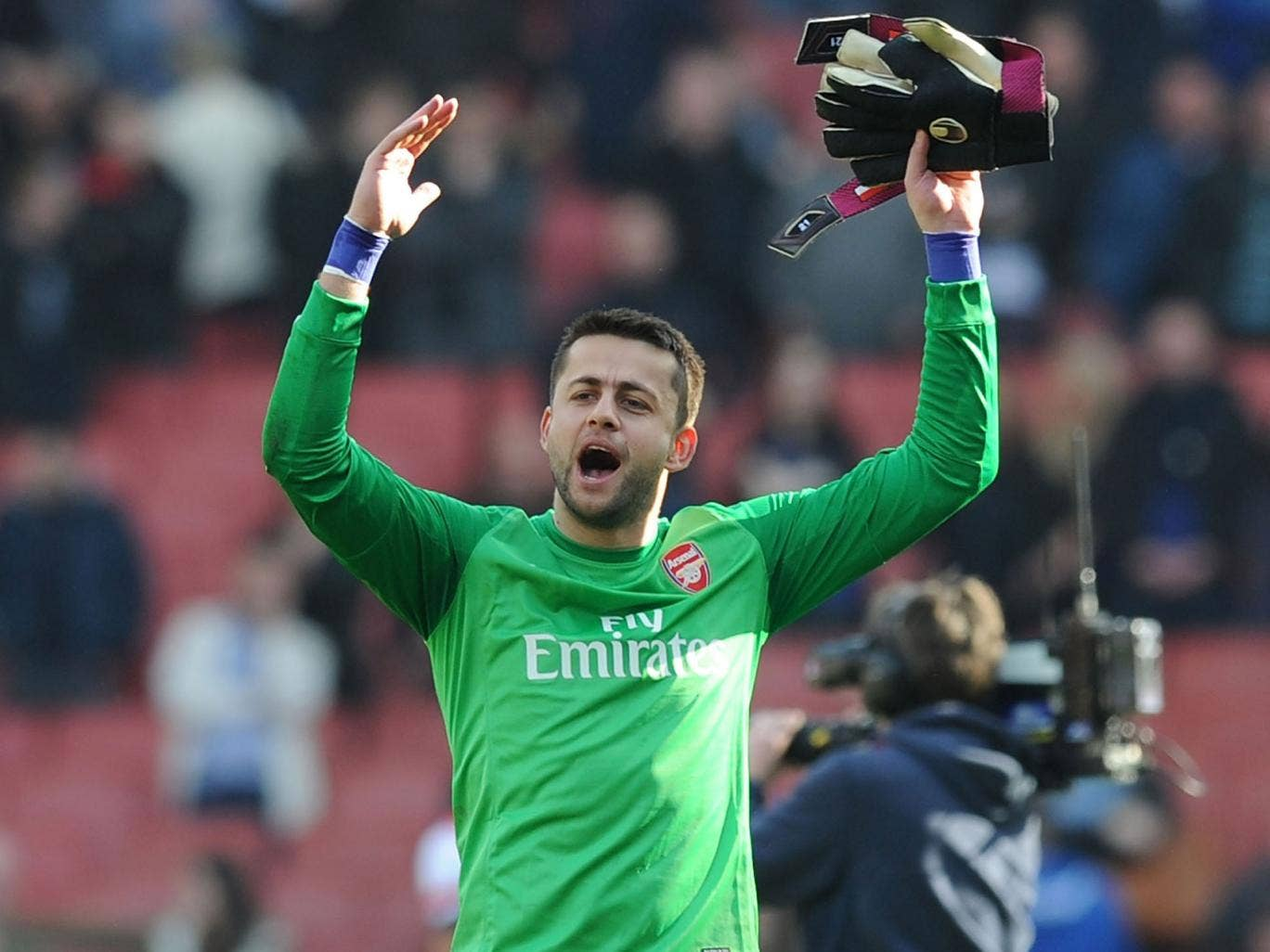 Arsenal goalkeeper Lukasz Fabianski celebrates after the FA Cup quarter-final match between Arsenal and Everton on Saturday