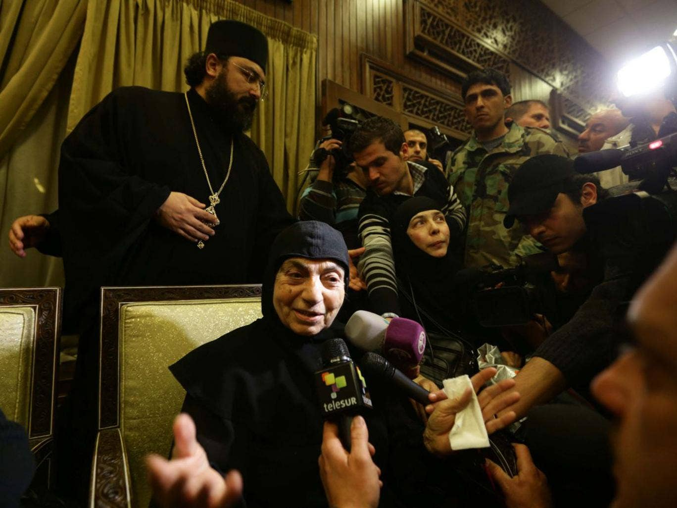 Kidnapped nuns talk to the media at Jdeidet Yabus on the Syrian side of the border with Lebanon after an arduous nine-hour journey yesterday