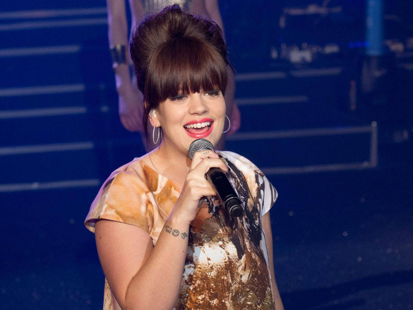 Lily Allen agreed with a fan on Twitter who called her Sheezus songs so far 'disappointing' and 'docile'