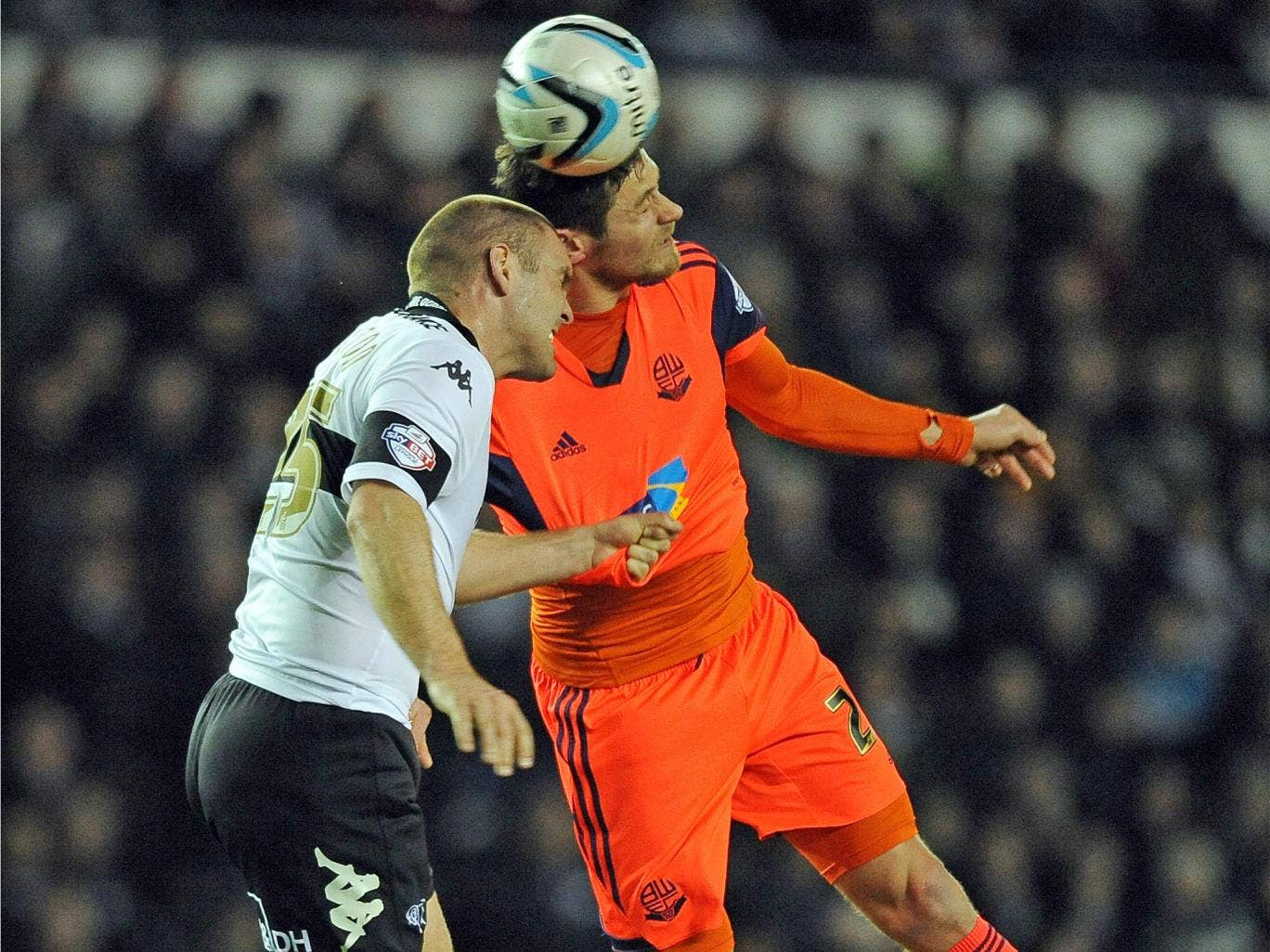 An aerial battle between Derby's Shaun Barker and Bolton's Lukas Jutkiewicz