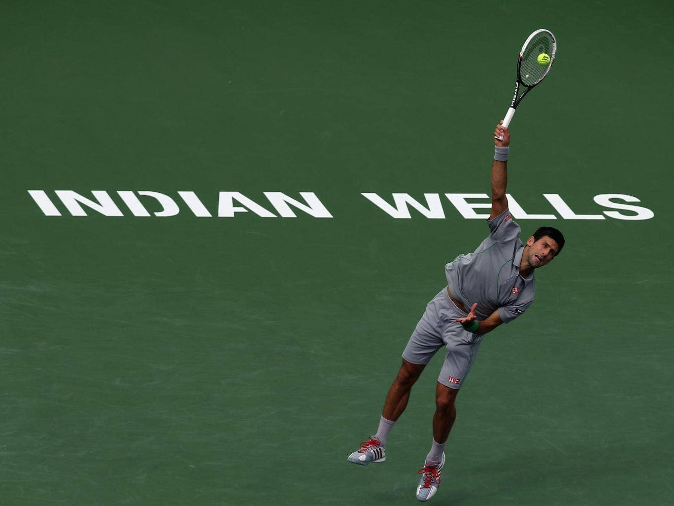Novak Djokovic of Serbia serves to Alejandro Gonzalez of Colombia during the BNP Paribas Open at Indian Wells