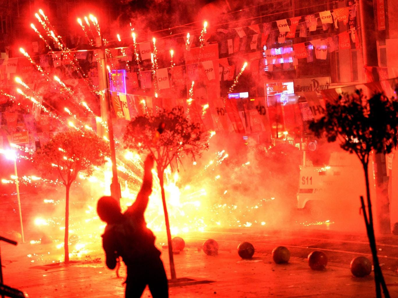 Fireworks thrown by protesters against Turkish riot police explodes and illuminates the scene during a demonstration in Istanbul