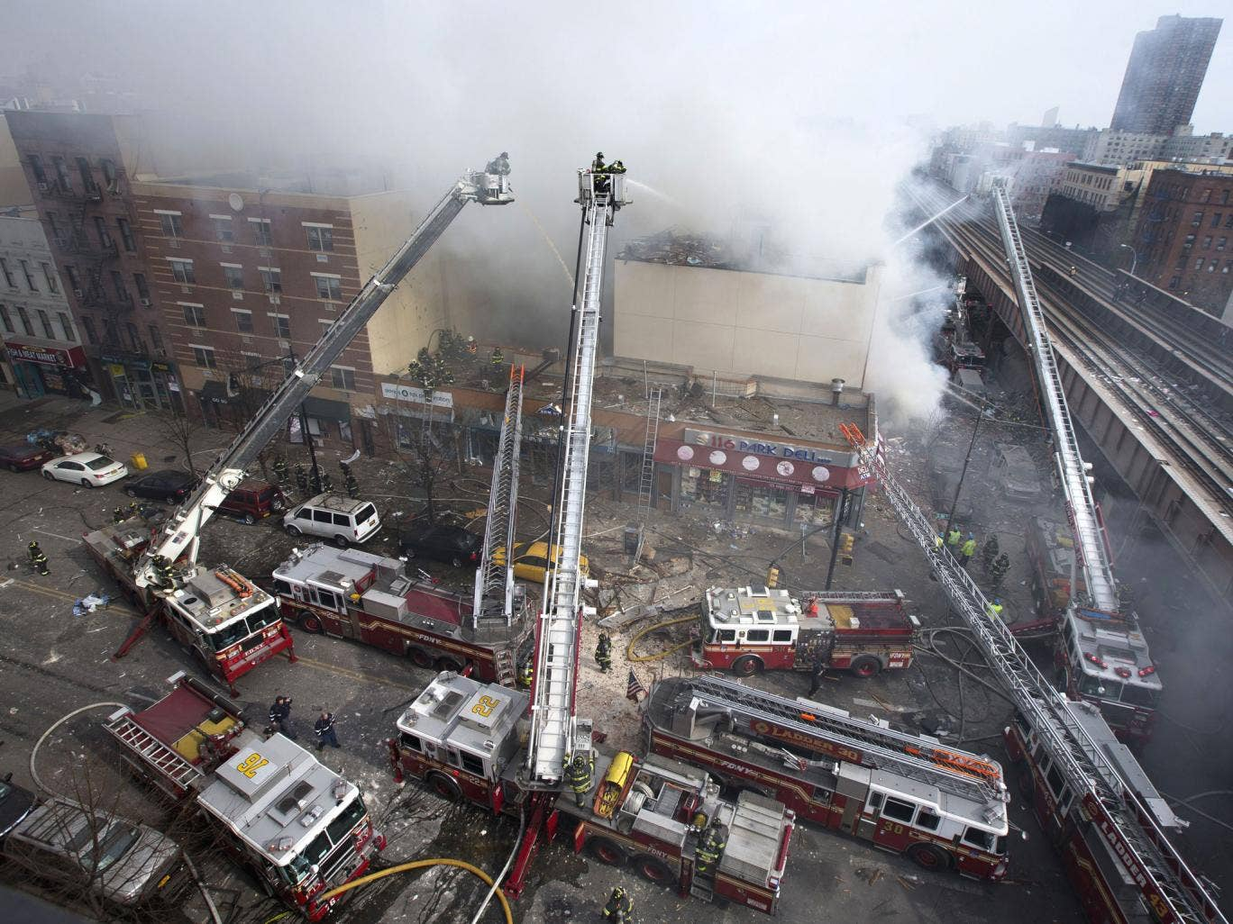 Firefighters battle a fire after a building collapse in the East Harlem neighborhood of New York