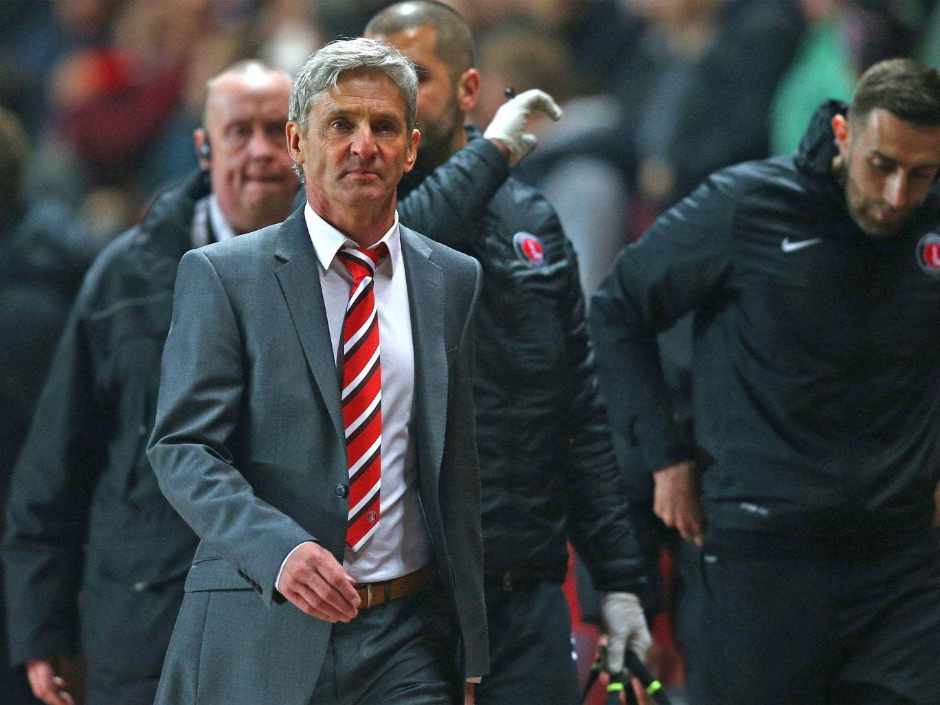 Jose Riga walks to the Charlton dugout