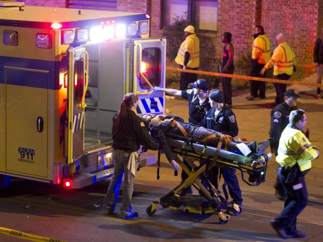 A man is transported to an ambulance after being struck by a vehicle on Red River Street in downtown Austin, Texas, during SXSW