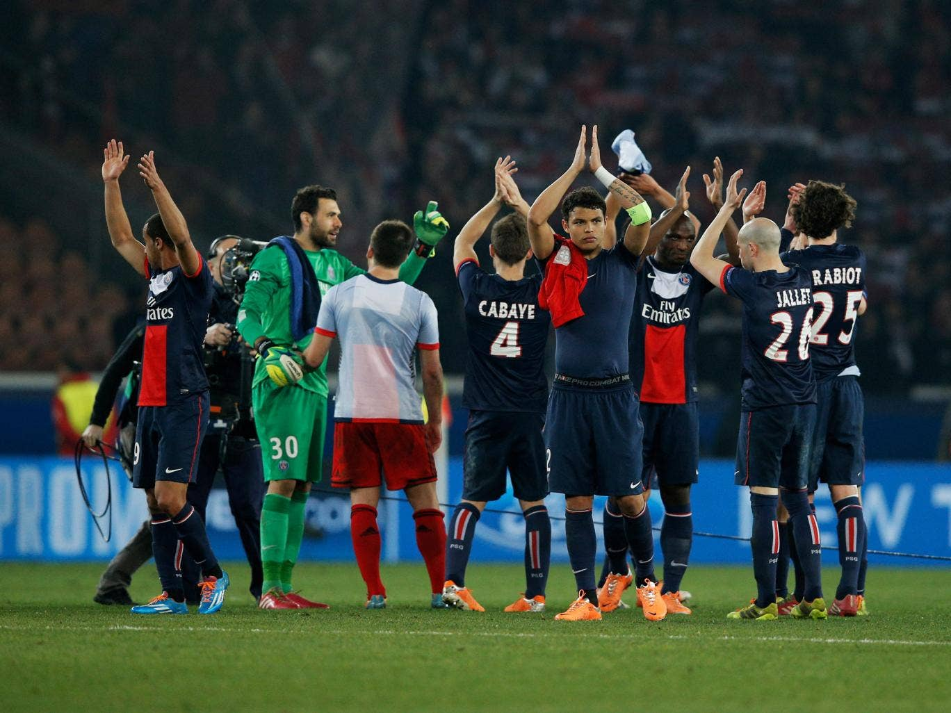PSG players celebrate victory after the Champions League Round of 16 second leg match against Bayer Leverkusen at Parc des Princes