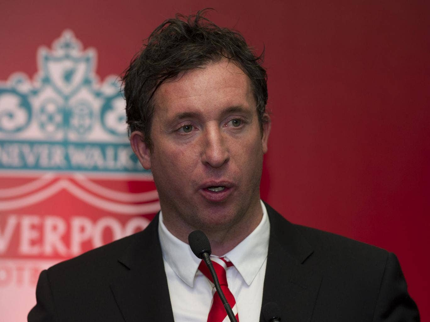 Former Liverpool Football Club and England striker Robbie Fowler speaks to media at an event in New Delhi on January 6, 2014.