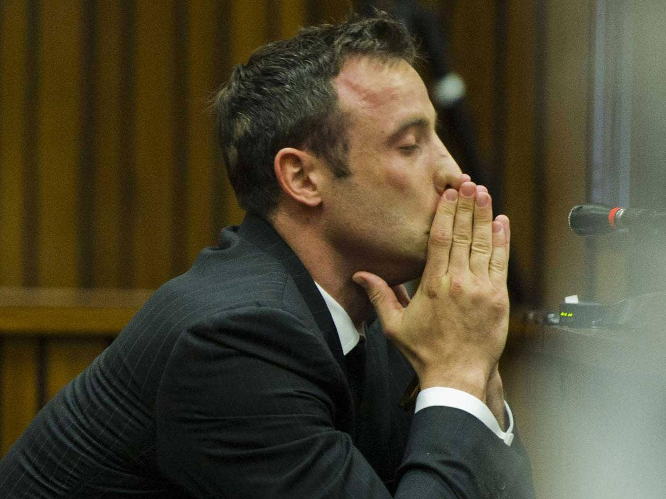 Oscar Pistorius sits in the dock during his murder trial at the North Gauteng High Court in Pretoria