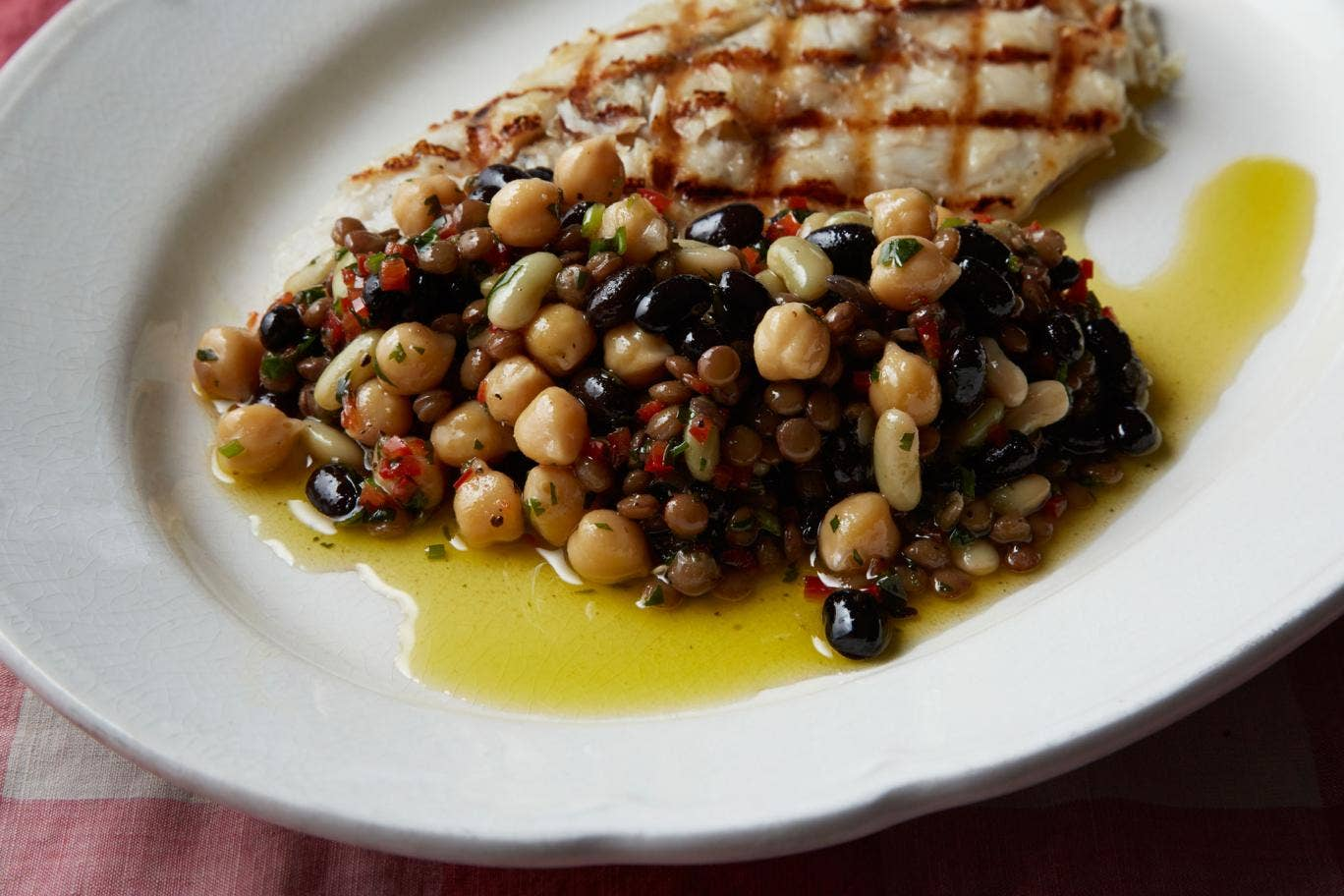 Mixed bean salad accompanying a fish dish