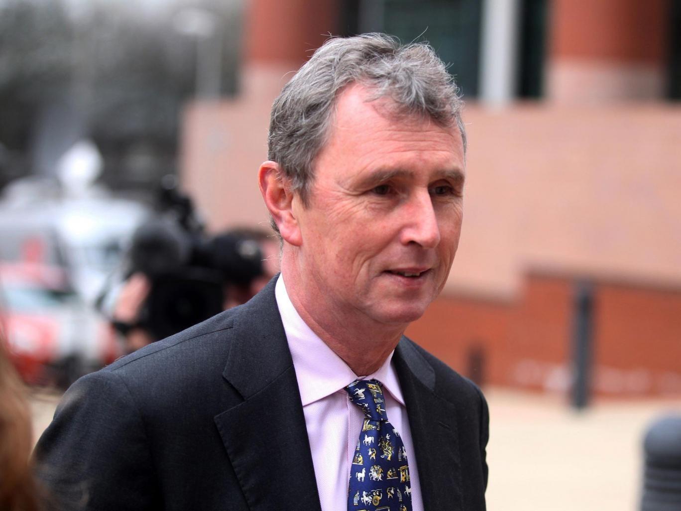 The former deputy speaker of the House of Commons Nigel Evans arrives at court