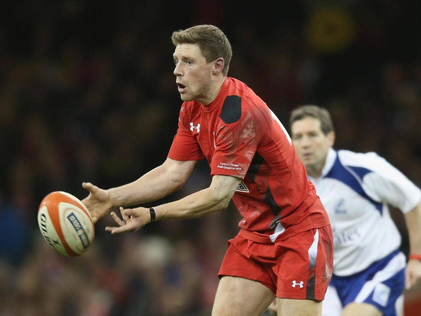 Rhys Priestland of Wales passes the ball